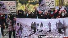 Afghan protesters hold a poster with Persian that reads, The main perpetrators of barbaric stoning of Rokhshana are Abdullah, Ghani, Karzai and their criminal partners, during a protest by the Solidarity Party of Afghanistan in Kabul, Afghanistan, Friday, Nov. 6, 2015. Rokhshana, a 22-year-old Afghan woman, was thrown in a hole in the ground and stoned to death by a group of men identified as Taliban insurgents after she was accused of adultery, an Afghan official said on Wednesday. (AP Photo/Rahmat Gul) Copyright: picture-alliance/AP Photo/R. Gul