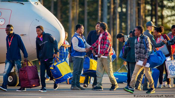 Eritrean refugees are resettled from Italy to Sweden.