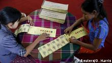 07.11.2015 *** Women label ballots at a polling station ahead of tomorrow's general election in Mandalay, Myanmar, November 7, 2015. Myanmar on November 8 is holding its first free and fair election in 25 years in which democracy icon Aung San Suu Kyi is pitted against the ruling party comprised of former members of a military junta. REUTERS/Olivia Harris Reuters/O. Harris