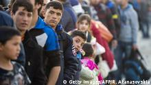Migrants and refugees wait for a train heading to Serbia from the Greek-Macedonian border near Gevgelija on November 5, 2015. The flow of refugees and other migrants from Turkey to Greece is expected to continue at a rate of 5,000 daily this winter, the UN refugee agency UNHCR said. Three million migrants fleeing war and poverty are seen entering the EU by 2017 in a development likely to have a marginal positive impact on the economy, the European Commission said on November 5. AFP PHOTO / ROBERT ATANASOVSKI (Photo credit should read ROBERT ATANASOVSKI/AFP/Getty Images)