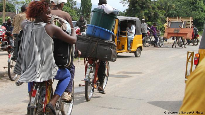 Burundians carry their belongings on bicycles in Bujumbura, Burundi