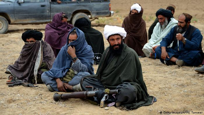 Afghan Taliban fighters listen to Mullah Mohammad Rasool Akhund (unseen), the newly appointed leader of a breakaway faction of the Taliban, at Bakwah in the western province of Farah (Photo: Getty Images/AFP/J. Tanveer)