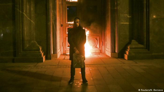 One of Russia's most radical political performance artists detained in Moscow after setting fire to the entrance of the headquarters of the FSB security Service. Copyright: REUTERS/Nigina Beroeva