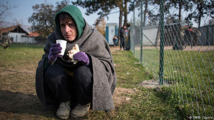 An Afghan refugee, eats and recuperates in Dimitrovgrad refugee camp after crossing the Serbian-Bulgarian border on foot