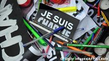 A picture taken on January 8, 2015 shows pens and signs reading 'I am Charlie'' in La Rochelle during a gathering to pay tribute to the twelve people killed the day before in an attack by two armed gunmen on the offices of French satirical newspaper Charlie Hebdo in Paris. A huge manhunt for two brothers suspected of massacring 12 people in an Islamist attack at a satirical French weekly zeroed in on a northern town Thursday after the discovery of one of the getaway cars. As thousands of police tightened their net, the country marked a rare national day of mourning for Wednesday's bloodbath at Charlie Hebdo magazine in Paris, the worst terrorist attack in France for half a century. AFP PHOTO / XAVIER LEOTY (Photo credit should read XAVIER LEOTY/AFP/Getty Images) Getty Images/AFP/X.Leoty picture-alliance/dpa/A.. Burgi