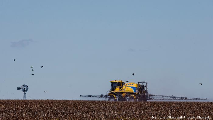 A tractor dusts a field in Argentina
