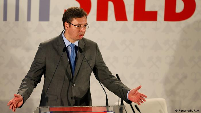 Serbian Aleksandar Vucic gestures with his arms during a conference speech.
