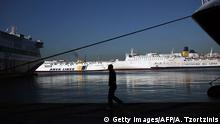 12.11.2015+++ A man walks past ferries docked at the port of Piraeus, southwest of central Athens, during a 24-hour strike on November 12, 2015. Greek unions kicked off a general strike against fresh austerity cuts, the first under the leftist government of Prime Minister Alexis Tsipras. The 24-hour strike against tax hikes and an upcoming pensions overhaul has shut down public services, hit ship and train transport and forced the cancellation of dozens of domestic flights. AFP PHOTO / ANGELOS TZORTZINIS (Photo credit should read ANGELOS TZORTZINIS/AFP/Getty Images) +++(C) Reuters/M. Karagiannis