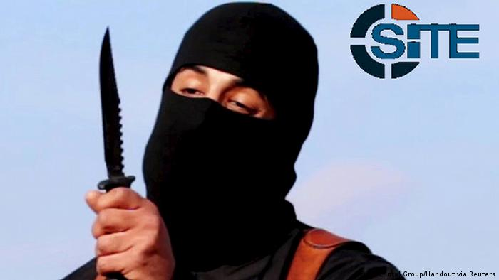 IS terroris Jihadi John, aka, Mohammed Emwaziholds up a large hunting knife, while his face, except for his eyes, is covered by a balaclava