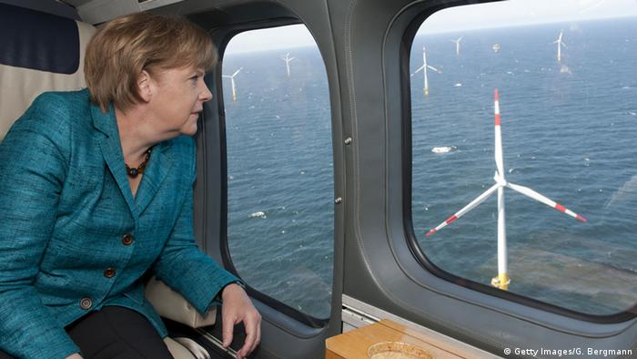 German Chancellor Angela Merkel looking out the window of an airplane at offshore wind park (Photo: Getty Images/G. Bergmann)