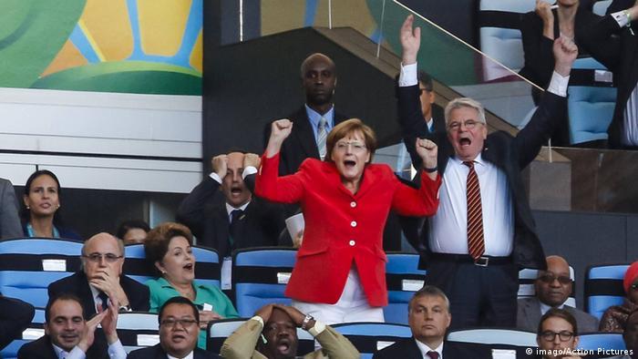 Joachim Gauck and Angela Merkel cheering