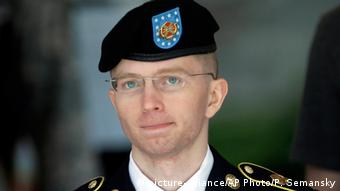 Then-Army Pfc. Bradley Manning, is escorted out of a courthouse in Fort Meade, Md., after the third day of his court martial.
