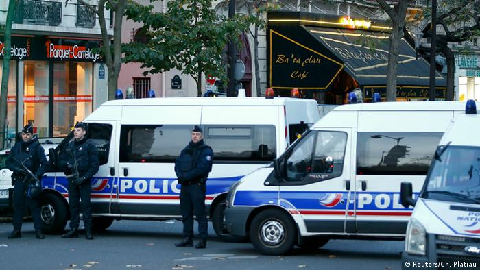 Police vehicles block the street in front of the Bataclan concert hall