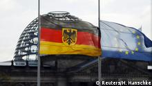 14.11.2015 The German and the European Union flags of the chancellery are seen flying at half-mast in front of Reichstag building in Berlin, Germany, November 14, 2015, after the attacks in Paris on Friday. Copyright: Reuters/H. Hanschke