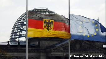 The German and the European Union flags of the chancellery are seen flying at half-mast in front of Reichstag building (Reuters/H. Hanschke)