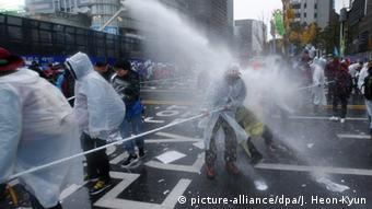 South Korean police uses water cannons against protesters marching towards the presidential house in Seoul, South Korea