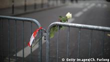 14.11.2015 PARIS, FRANCE - NOVEMBER 14: Floral tributes are placed on the police cordon near the scene of the Bataclan Theatre terrorist attack on November 14, 2015 in Paris, France. At least 120 people have been killed and over 200 injured, 80 of which seriously, following a series of terrorist attacks in the French capital. Copyright: Getty Images/Ch. Furlong