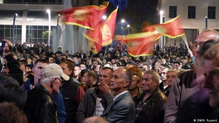 Crowds waving flags during anti-government demo in Podgorica