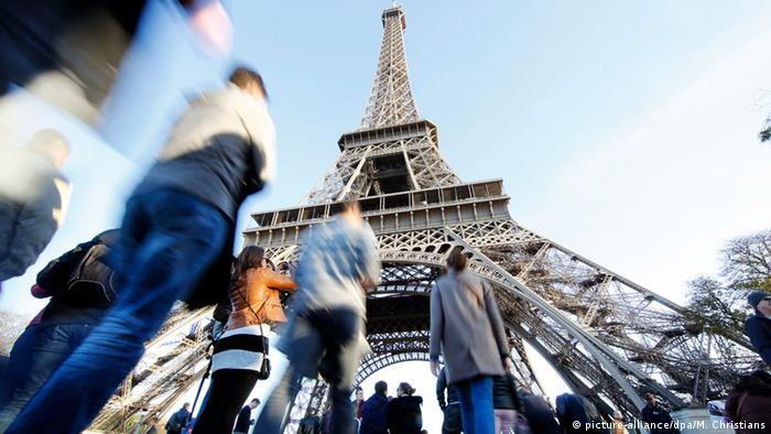 Tourists visit the Eifel Tower in Paris.