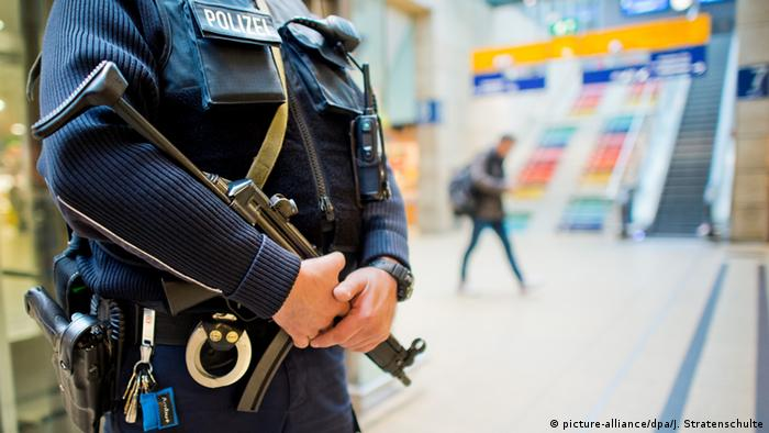 A German police officer patrols the Hanover main train station