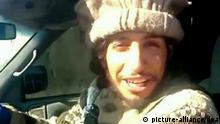 This undated image taken from a Militant Website on Monday Nov. 16, 2015 showing Belgian Abdelhamid Abaaoud. A French official says Abdelhamid Abaaoud is the suspected mastermind of the Paris attacks was also linked to thwarted train and church attacks. (Militant video via AP)