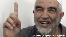 Leader of the radical northern wing of the Islamic Movement in Israel, Sheikh Raed Salah, gestures after he was convicted at a Jerusalem court on October 27, 2015. An Israeli court upheld a conviction of the firebrand Islamic cleric and jailed him for 11 months for inciting violence over Jerusalem's Al-Aqsa mosque in 2007. AFP PHOTO / AHMAD GHARABLI (Photo credit should read AHMAD GHARABLI/AFP/Getty Images)