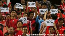 Hong Kong soccer fans boo the Chinese national anthem