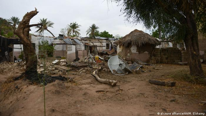 Ruined houses are seen after retreating Boko Haram attacked them in the city of Yola in Adamawa province, Nigeria