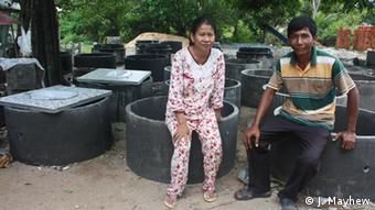 Suppliers Chhum Nimol (left) and Chhum Seab have more than doubled their income with the growing demand for toilets