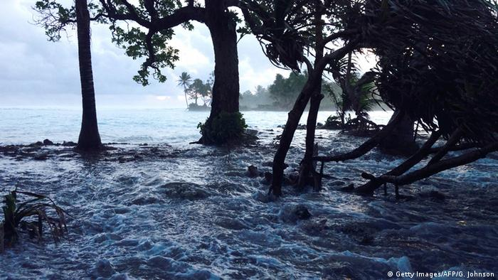 A high tide energized by storm surges washes across Ejit Island in Majuro Atoll, Marshall Islands