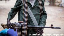 A member of South Sudanese anti-government forces poses for a photo with his machine gun on March 4, 2014, in Malakal, South Sudan. Almost 40,000 people may have been displaced by militia arson and looting in Sudan's Darfur region, according to new data obtained by AFP on March 4, 2014. More than 19,000 arrivals have been recorded at two camps for displaced people near the South Darfur state capital, Nyala, the International Organisation for Migration said. AFP PHOTO / ANDREI PUNGOVSCHI (Photo credit should read ANDREI PUNGOVSCHI/AFP/Getty Images)
