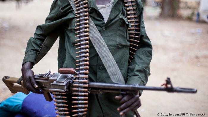 A gunman holding a machine gun