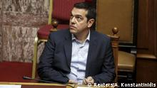 Greek Prime Minister Alexis Tsipras looks on during a parliamentary session for a reforms bill vote in Athens, Greece November 19, 2015. The Greek parliament on Thursday passed measures demanded by its foreign lenders in exchange for 2 billion euros in bailout funds and a further 10 billion euros to recapitalise its top banks. REUTERS/Alkis Konstantinidis