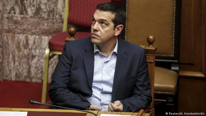 Greek Prime Minister Alexis Tsipras looks on during a parliamentary session for a reforms bill vote in Athens, Greece