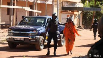 Police escorting a freed hostage from the Mali Radison Hotel attack