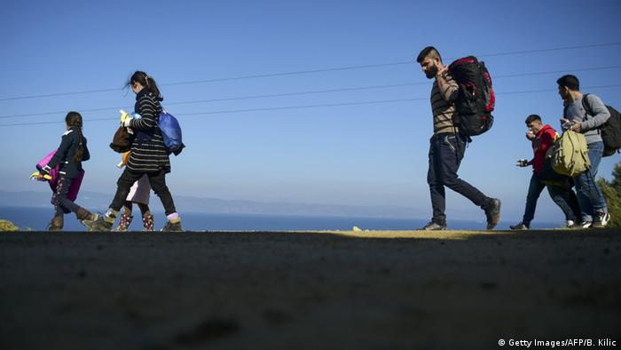 Archive Image: Syrian refugees walk up to the hill after arriving on the Greek island of Lesbos after crossing the Aegean Sea from Turkey November 2015.