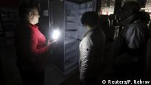 22.11.2015 *** An employee (L) speaks with people at an electronics store, with the power turned off inside, in Simferopol, Crimea, November 22, 2015. A state of emergency has been declared in Crimea after pylons carrying electricity from Ukraine were blown up cutting off power to almost two million people, media and the Russian government said on Sunday. REUTERS/Pavel Rebrov Reuters/P. Rebrov