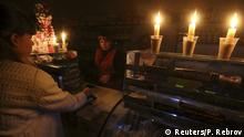 22.11.2015 *** A customer visits a grocery lit with candles due to a power cut, in Simferopol, Crimea, November 22, 2015. REUTERS/Pavel Rebrov Reuters/P. Rebrov