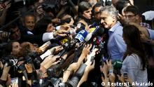 22.11.2015 *** Mauricio Macri, presidential candidate of Cambiemos (Let's Change) listens to questions as he talks to the media at a polling station after casting his vote in Argentina's presidential election in Buenos Aires, Argentina, November 22, 2015. Argentines voted on Sunday in a run-off election that hands the center-right opposition, led by Mauricio Macri, its best chance in more than a decade to wrest the presidency from the populist Peronists. A win by Macri would set Argentina's spluttering economy on a more free-market course that he promises would rebuild investor confidence. Outgoing President Cristina Fernandez de Kirchner, who was preceded in office by her late husband Nestor Kirchner, is as revered by the poor for her generous welfare programs as she is reviled by business for the strict controls the couple put on the economy during their 12 years in power. REUTERS/Ivan Alvarado Reuters/I. Alvarado