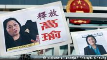 FILE - In this April 17, 2015 file photo, pictures of jailed veteran Chinese journalist Gao Yu are displayed by protesters outside Chinese central government's liaison office in Hong Kong. A lawyer for the 71-year-old Chinese journalist imprisoned on a conviction of leaking state secrets said Tuesday, Nov. 24, 2015, that a Beijing court has heard the woman's appeal in a closed-door session and that a decision will be announced later. The placards read Release Gao Yu. (AP Photo/Kin Cheung, File) picture-alliance/AP Photo/K. Cheung