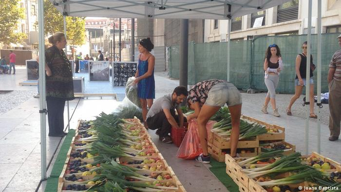 Customers arrive at collection points in Lisbon to pick up their 'ugly' fruit
