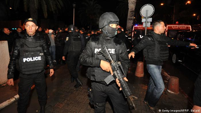 Tunisian police block the road leading to the site of an explosion on a bus transporting Tunisia's presidential guard in central Tunis in November 2015