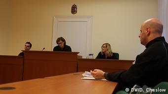 Attorney Gabor Gyösö argues against the expulsion of a Syrian migrant in court in Szeged