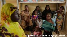 Women and children rescued by Nigerian soldiers from Boko Haram extremists at Sambisa Forest rest at a refugee camp in Yola, Nigeria Sunday, May 3, 2015, after being rescued from captivity by Boko Haram fighters. Their faces were gaunt with signs of malnutrition but the girls are alive and free, among a group of 275 children and women rescued by the Nigerian military, and the first to arrive at a refugee camp Saturday after a three-day journey to safety. They came from the Sambisa Forest, thought to be the last stronghold of the Islamic extremists, where the Nigerian military said it has rescued more than 677 girls and women and destroyed more than a dozen insurgent camps in the past week. ( AP Photo/Sunday Alamba)