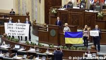 27.11.2015 epa05044414 Ukrainian parliament members stage a small protest against Russia as Sergey Naryshkin, the Speaker of Russian State Duma, addresses to Parliamentary Assembly of the Black Sea Economic Cooperation (PABSEC) international meeting held at Parliament Palace in Bucharest, Romania, 27 November 2015. Despite his ban to travel into EU, Sergey Naryshkin was allowed to enter Romania in order to attend the ceremony in which the presidency of PABSEC was handed from Romanian Parliament toward the Russia's Federal Assembly. The Summit Declaration on Black Sea Economic Cooperation and the Bosphorus Statement, signed in Istanbul on 25 June 1992, defined the basic principles and objectives of the Black Sea Economic Cooperation (BSEC), formally instituting a new regional cooperation process with participation of eleven countries: Albania, Armenia, Azerbaijan, Bulgaria, Georgia, Greece, Moldova, Romania, the Russian Federation, Turkey and Ukraine. EPA/STR picture-alliance/dpa