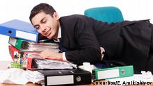 Young busy businessman at his desk Colourbox/Elnur Amikishiyev