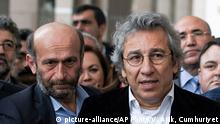 In this Thursday, Nov. 26, 2015 photo, Can Dundar, right, the editor-in-chief of opposition newspaper Cumhuriyet, and Erdem Gul, left, the paper's Ankara representative, speak to the media outside a courthouse in Istanbul, Turkey. In new blow to media freedoms in Turkey, a court on Thursday ordered the two prominent opposition journalists jailed pending trial over charges of willingly aiding an armed group and of espionage for revealing state secrets for their reports on alleged arms smuggling to Syria. In May, the Cumhuriyet paper published what it said were images of Turkish trucks carrying ammunition to Syrian militants. (Vedat Arik/Cumhuriyet via AP) TURKEY OUT Copyright