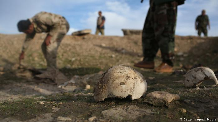Kurdish Peshmerga show what they say is a mass grave of more than 50 Yazidis killed by ISIL on November 15, 2015 in Sinjar, Iraq.