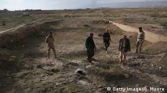 Massengrab im Irak, Foto: John Moore, Getty Images