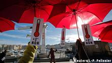 Environmental activists hold red umbrellas as they take part in a symbolic human chain gathering, after the cancellation of a planned climate march following shootings in the French capital, ahead of the World Climate Change Conference 2015 (COP21), in Marseille, France, November 29, 2015. Reuters/J.-P. Pelissier TPX IMAGES OF THE DAY